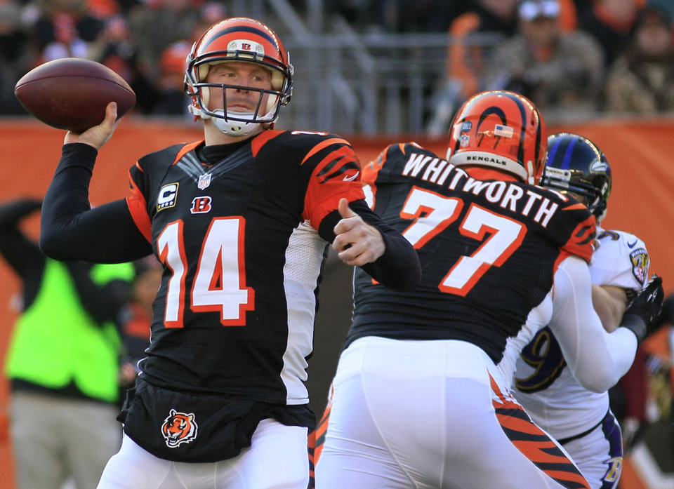 Photo - Cincinnati Bengals quarterback Andy Dalton (14) passes against the Baltimore Ravens in the first half of an NFL football game on Sunday, Dec. 30, 2012, in Cincinnati. (AP Photo/Tom Uhlman)