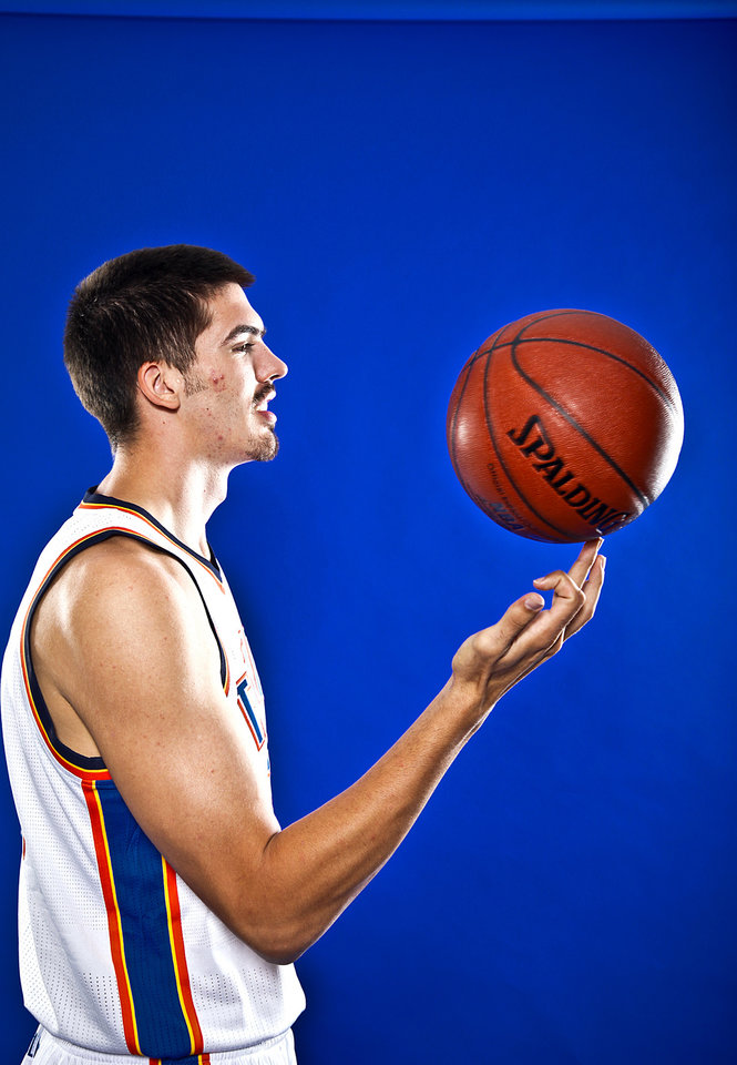 Photo - BYRON MULLENS poses for a photo during the Oklahoma City Thunder media day on Monday, Sept. 27, 2010, in Oklahoma City, Okla.   Photo by Chris Landsberger, The Oklahoman