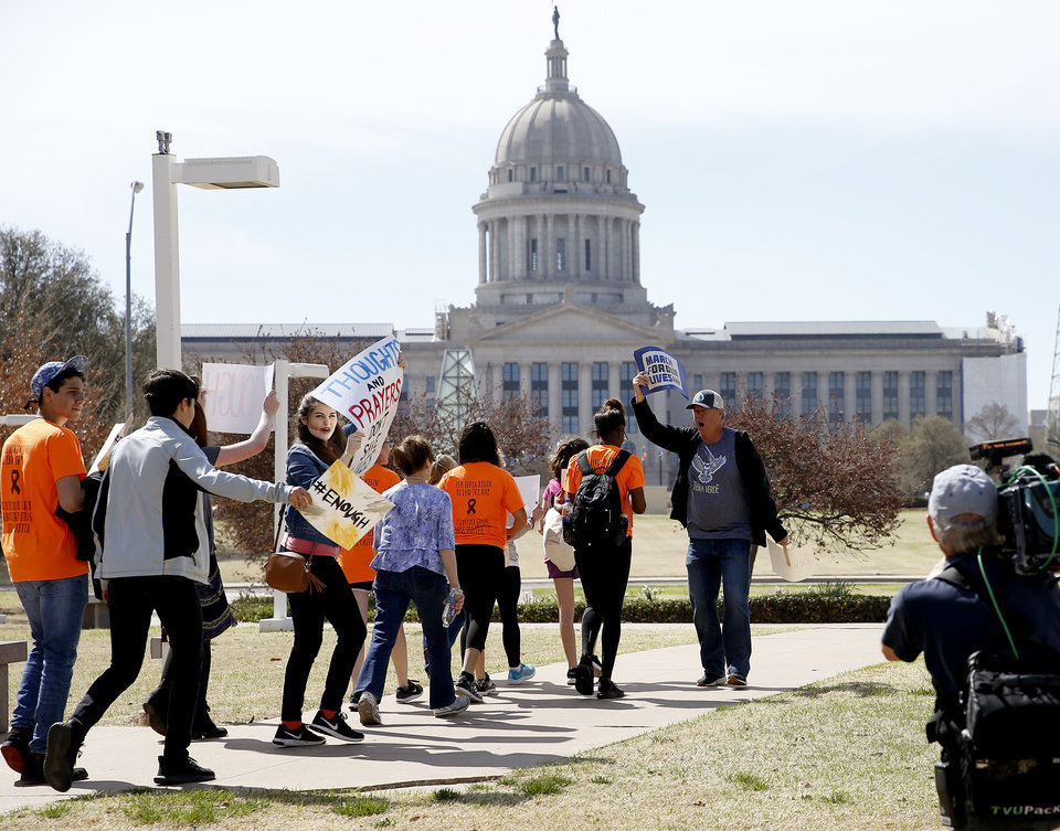 "Photo - People walk towards the state Capitol during a ""March for Our Lives"" rally in support of gun control in Oklahoma City, Saturday, March 24, 2018. Photo by Bryan Terry, The Oklahoman"
