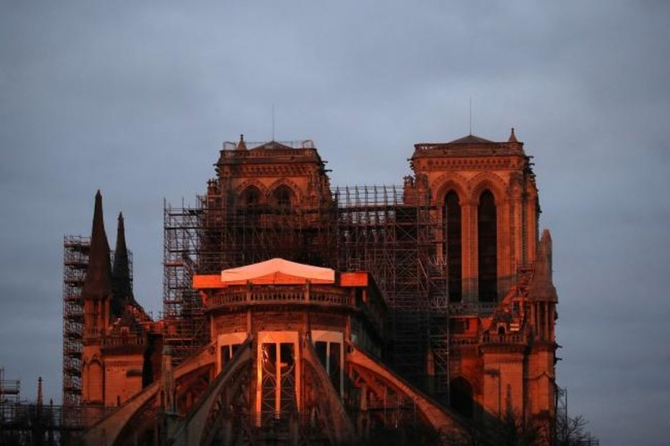 Photo -  Notre Dame cathedral is pictured when the sun rises Jan. 5 in Paris. [AP PHOTO]