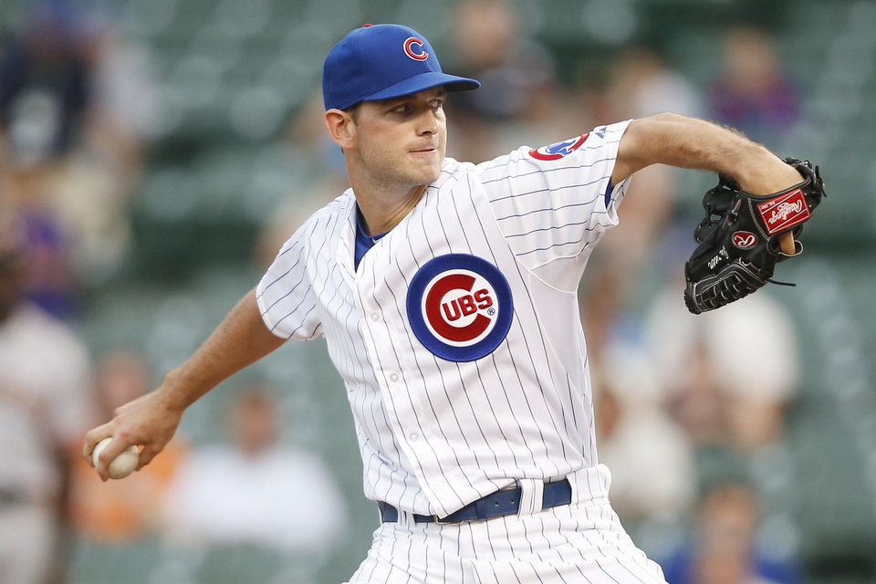 Photo - Chicago Cubs relief pitcher Jacob Turner delivers against the San Francisco Giants during the sixth inning of the continuation of a baseball game that began Tuesday, on Thursday, Aug. 21, 2014, in Chicago. Tuesday's game was suspended in the fifth inning due to rain. (AP Photo/Andrew A. Nelles)