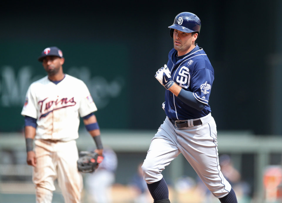 Photo - San Diego Padres' Seth Smith, right, rounds the bases on his decisive solo home run off Minnesota Twins relief pitcher Anthony Swarzak in the 10th inning of a baseball game, Wednesday, Aug. 6, 2014, in Minneapolis. The Padres won 5-4.  (AP Photo/Jim Mone)
