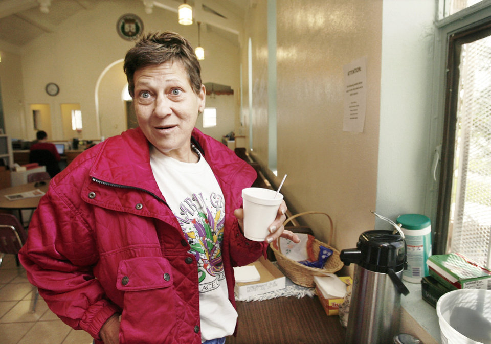 Dolores Colwell, 50, stops by the coffee table on her way out of the Sanctuary Women's Development Center in Oklahoma City. Colwell is living at the City Rescue Mission in downtown Oklahoma City. Oklahoma City's poverty rate is estimated to be about 16.4 percent, according to recent census numbers.