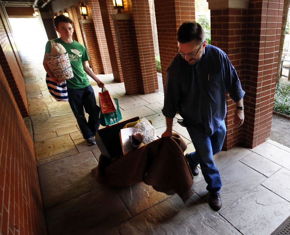 Photo - Family members Harrison, left (brother), and Brad (dad) help move Haley Morrow into honors dorms at the University of Oklahoma Wednesday. Photo by Steve Sisney, The Oklahoman  STEVE SISNEY - THE OKLAHOMAN