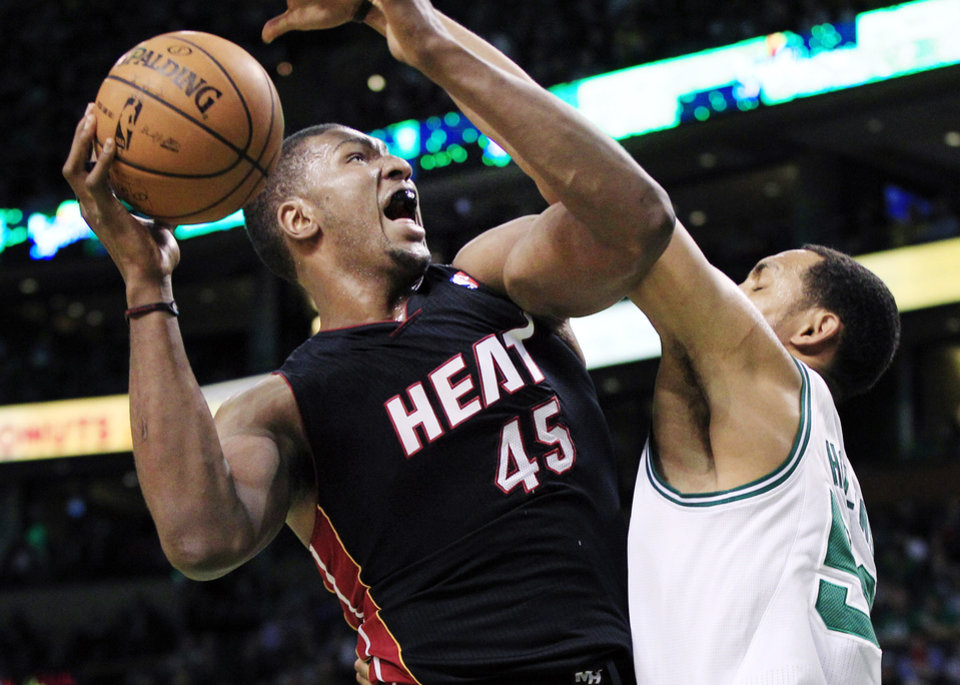 Miami Heat center Dexter Pittman (45) shoots against Boston Celtics center Ryan Hollins, right, during the first quarter of an NBA basketball game in Boston, Tuesday, April 24, 2012. (AP Photo/Elise Amendola)
