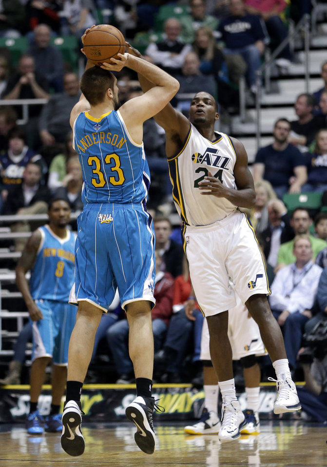 New Orleans Hornets' Ryan Anderson (33) shoots as Utah Jazz's Paul Millsap (24) defends in the second quarter during an NBA basketball game Wednesday, Jan. 30, 2013, in Salt Lake City. (AP Photo/Rick Bowmer)