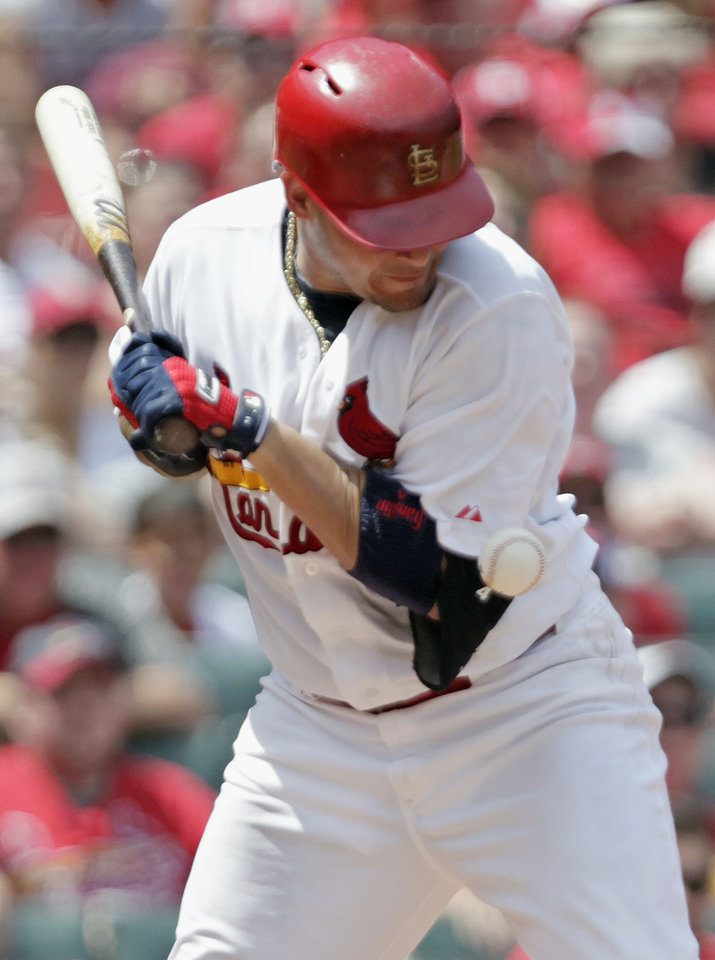 Photo - St. Louis Cardinals' Yadier Molina is hit by a psych from Miami Marlins starting pitcher Henderson Alvarez in the fourth inning of a baseball game, Sunday, July 6, 2014 in St. Louis. (AP Photo/Tom Gannam)