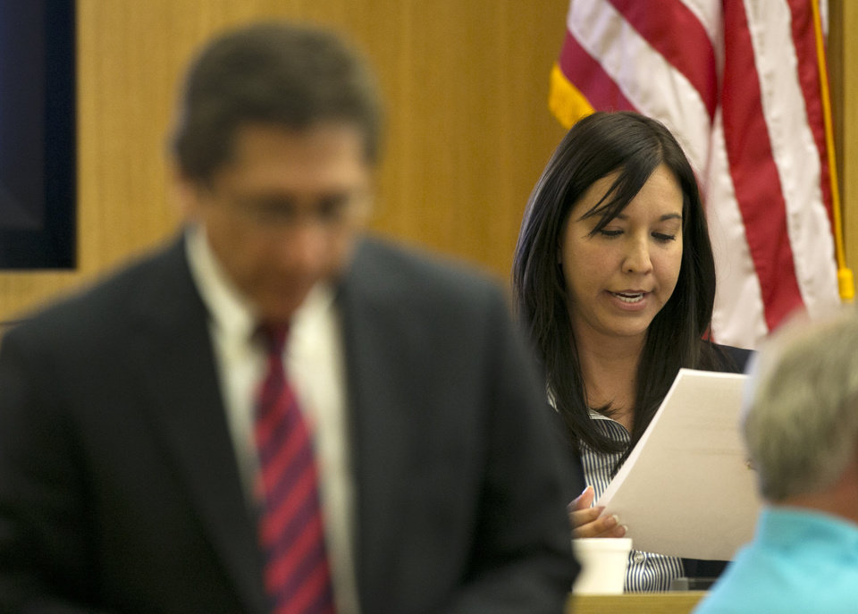 Photo - Dr. Janeen DeMarte an expert witness for the prosecution reads evidence as Prosecutor Juan Martinez looks on during the Jodi Arias trial at Maricopa County Superior Court in Phoenix on Tuesday, April 16, 2013. Defense attorneys rested their case Tuesday after about 2 1/2 months of testimony aimed at portraying Arias as a domestic violence victim who fought for her life the day she killed her one-time boyfriend. (AP Photo/The Arizona Republic, David Wallace, Pool)