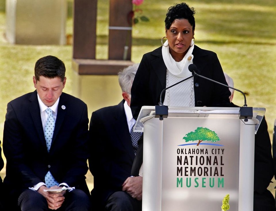 Photo - Helena Garrett, mother of bombing victim Tevin D'Aundrae Garrett, reads victim's names at the 23rd Anniversary Remembrance Ceremony of the Oklahoma City bombing on Thursday, April 19, 2018 in Oklahoma City, Okla.  [The Oklahoman Archives]