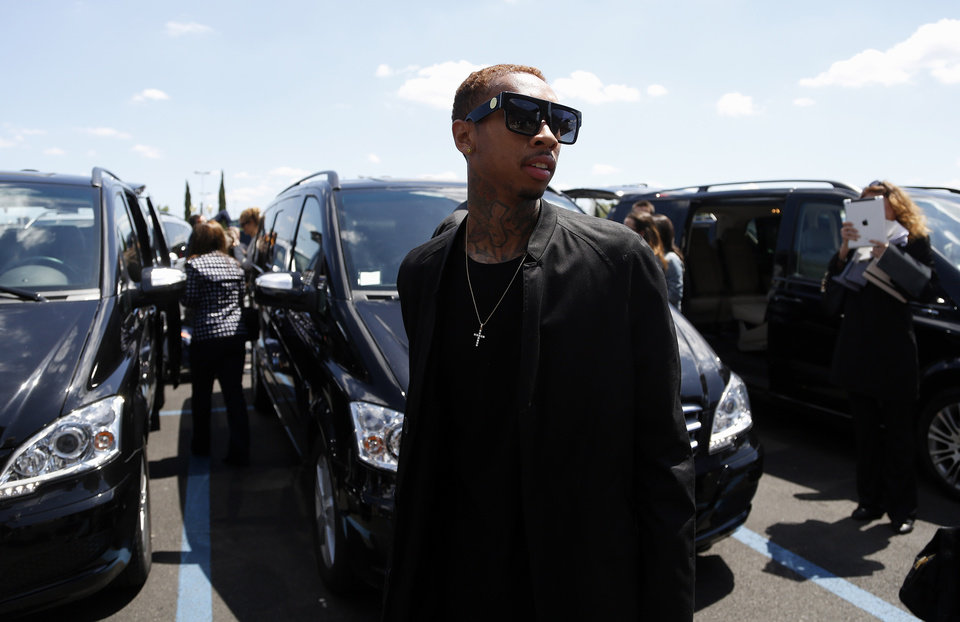 Photo - American rapper Tyga arrives in Florence, Italy, Saturday, May 24, 2014. Kim Kardashian and Kanye West will wed and host a reception at Florence's imposing 16th-century Belvedere Fort on May 24, according to a spokeswoman at the Florence mayor's office. The couple rented the fort, located next to Florence's famed Boboli Gardens, for 300,000 euros ($410,000) and a Protestant minister will preside over the ceremony. Belvedere Fort was built in 1590, believed using plans by Don Giovanni de' Medici. Located near the Arno River, it offers a panoramic view of Florence and the surrounding Tuscan hills.(AP Photo/Gregorio Borgia)