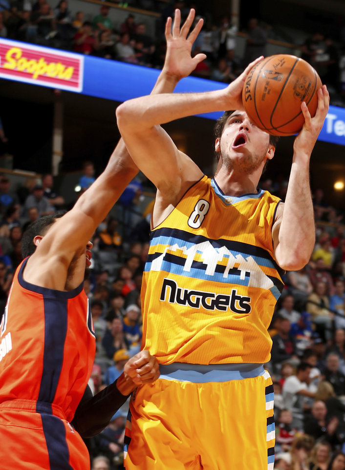 Photo - Denver Nuggets forward Danilo Gallinari (8) goes up for a shot against Oklahoma City Thunder forward Andre Roberson (21) during the second half of a basketball game Sunday, April 9, 2017, in Denver. (AP Photo/Jack Dempsey)