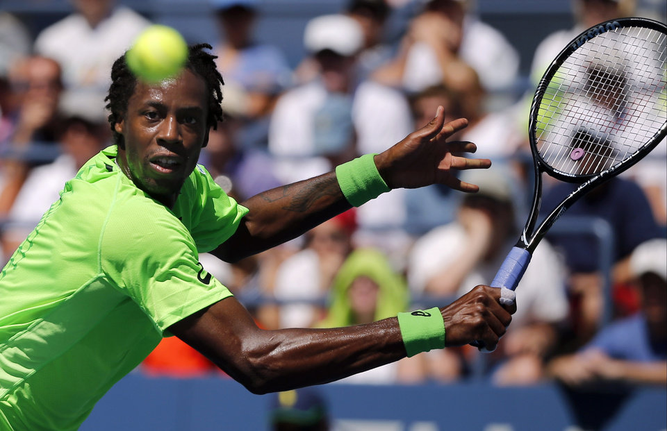 Photo - Gael Monfils, of France, returns a shot to Alejandro Gonzalez, of Colombia, during the second round of the 2014 U.S. Open tennis tournament, Friday, Aug. 29, 2014, in New York. (AP Photo/Elise Amendola)