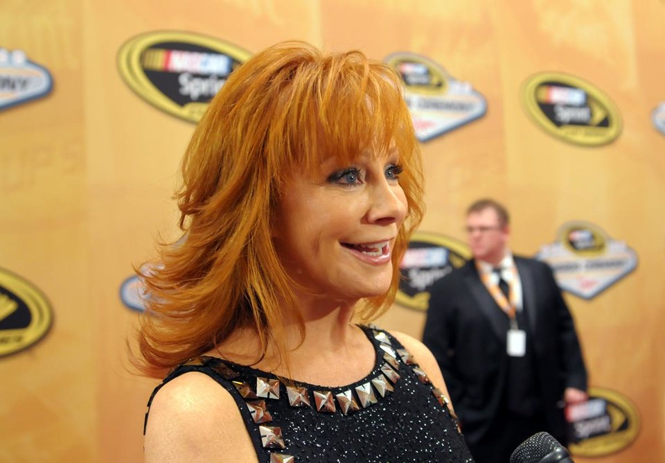 In this photo provided by the Las Vegas News Bureau, Reba McEntire walks the red carpet at the NASCAR Sprint Cup Series Champions Awards Ceremony at the Wynn Las Vegas. Hosted in Las Vegas for the past three years, the awards ceremony is the culmination of the annual Champion's Week, which includes autographs signings and a parade and burnout on the Las Vegas Strip by the top 12 drivers. Friday, December 2, 2011. (Photo/Las Vegas News Bureau, Darrin Bush)