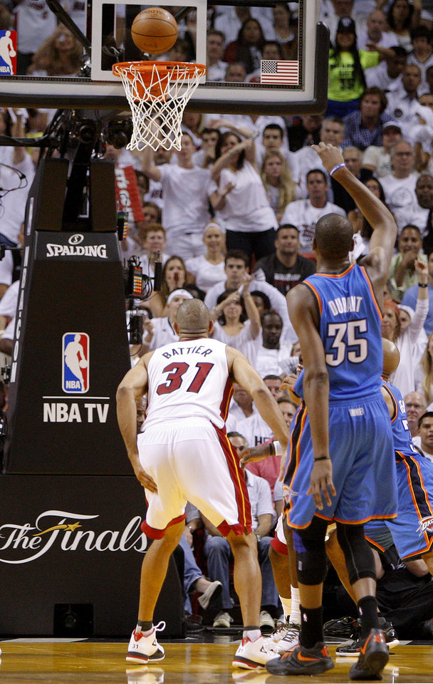 Photo - Oklahoma City's Kevin Durant (35) misses a free throw during Game 3 of the NBA Finals between the Oklahoma City Thunder and the Miami Heat at American Airlines Arena, Sunday, June 17, 2012. Photo by Bryan Terry, The Oklahoman