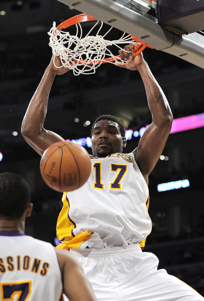 Photo -   Los Angeles Lakers center Andrew Bynum dunks during the first half of an NBA first-round playoff basketball game against the Denver Nuggets, Sunday, April 29, 2012, in Los Angeles. (AP Photo/Mark J. Terrill)