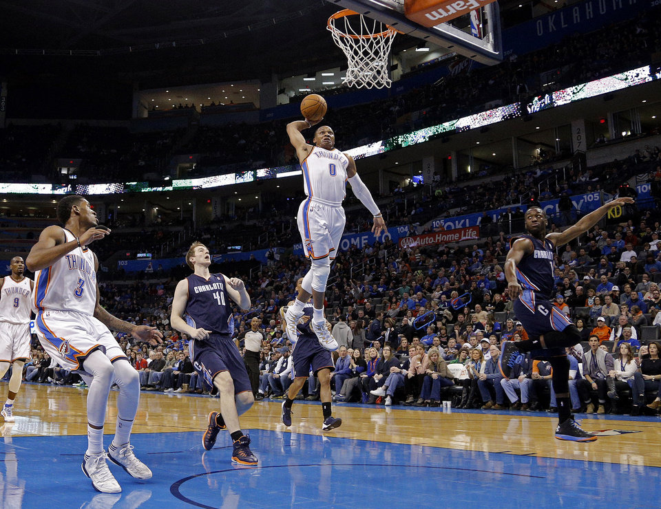 Photo - Oklahoma City 's Russell Westbrook (0) dunks during the NBA basketball game between the Oklahoma City Thunder and the Charlotte Bobcats at the Chesapeake Energy Arena, Sunday, March 2, 2014. Photo by Sarah Phipps, The Oklahoman