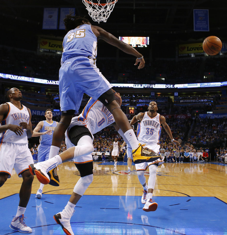 Denver's Kenneth Faried (35) blocks the shot of Oklahoma City's Russell Westbrook (0) during an NBA basketball game between the Oklahoma City Thunder and the Denver Nuggets at Chesapeake Energy Arena in Oklahoma City, Tuesday, March 19, 2013.Denver won 114-104. Photo by Bryan Terry, The Oklahoman