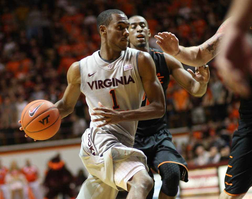 Virginia Tech guard Robert Brown (1) drives around Oklahoma State guard Markel Brown (22) during the second half of an NCAA college basketball game in Blacksburg, Va., Saturday, Dec. 1, 2012. (AP Photo/Daniel Lin) ORG XMIT: VADL114