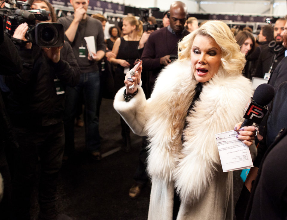 Photo - FILE - In this Feb. 14, 2012 file photo, Joan Rivers tours backstage with her camera crew for E!'s