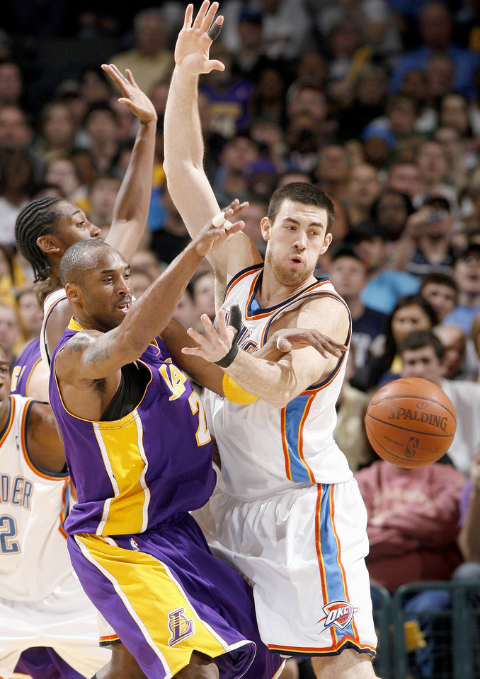 Kobe Bryant of the Lakers passes around Oklahoma City's Nick Collison during the NBA basketball game between the Los Angeles Lakers and the Oklahoma City Thunder at the Ford Center,Tuesday, Feb. 24, 2009. PHOTO BY BRYAN TERRY, THE OKLAHOMAN