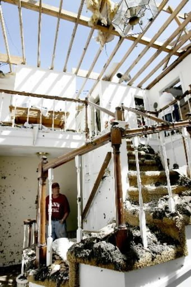 Lary Fullbright inside his Muldrow, Okla., home, Thursday, April 10, 2008. Fullbright's home was damaged the Wednesday night after severe storms moved through the area. Photo by Bryan Terry