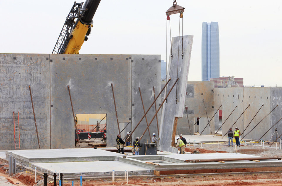 Photo -  Construction workers raise a concrete panel Wednesday for the Center of Hope being built by the Salvation Army Central Oklahoma Area Command at NW 10 and Pennsylvania Avenue in Oklahoma City. Photo by Paul B. Southerland, The Oklahoman   PAUL B. SOUTHERLAND -