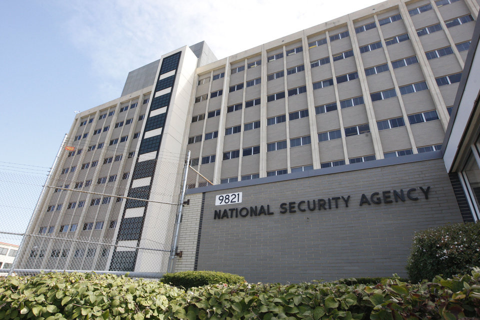 Photo - FILE - This Sept. 19, 2007, file photo, shows the National Security Agency building at Fort Meade, Md.  The government is secretly collecting the telephone records of millions of U.S. customers of Verizon under a top-secret court order, according to the Sen. Dianne Feinstein, D-Cailf., chairwoman of the Senate Intelligence Committee. The Obama administration is defending the National Security Agency's need to collect such records, but critics are calling it a huge over-reach. (AP Photo/Charles Dharapak, File)