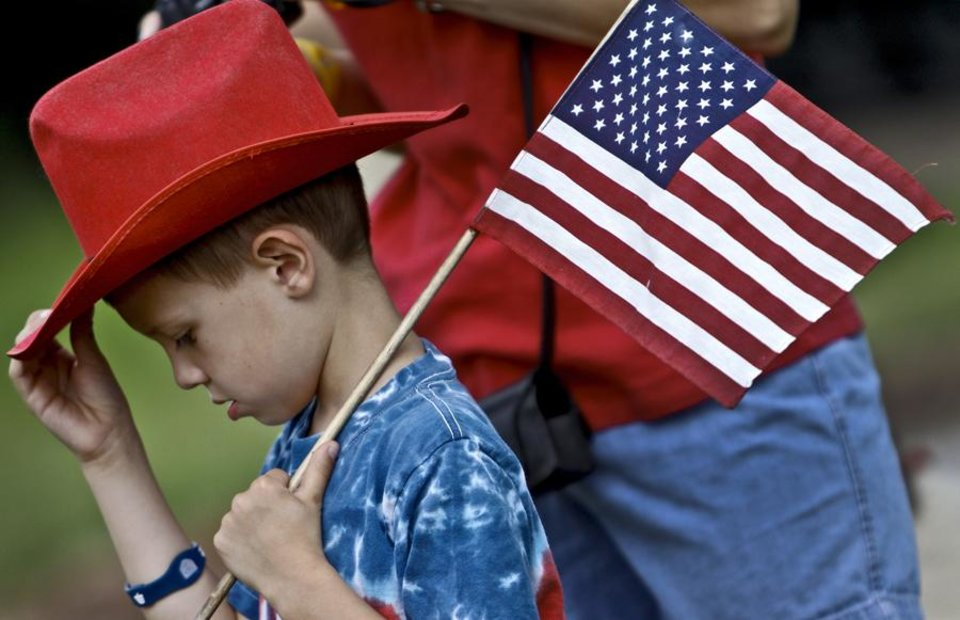 Photo -  Six-year-old Eric Kimbrough carries an American Flag during the 45th infantry Division Museum Memorial Day Ceremony on, Monday, May 30, 2011. Photo by Chris Landsberger, The Oklahoman ORG XMIT: KOD