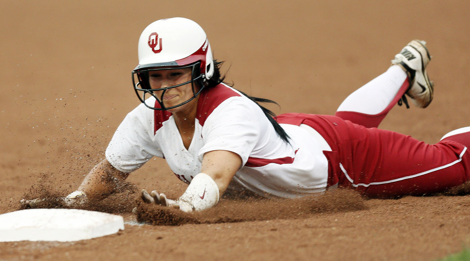 Photo - OU's Lauren Chamberlain (44) slides back to 3rd base after deciding not to try for home in the 1st inning during an NCAA softball game between OU and Marist in the Oklahoma Regional in Norman, Okla., Friday, May 17, 2013. Oklahoma won 17-0 in 5 innings. Photo by Nate Billings, The Oklahoman