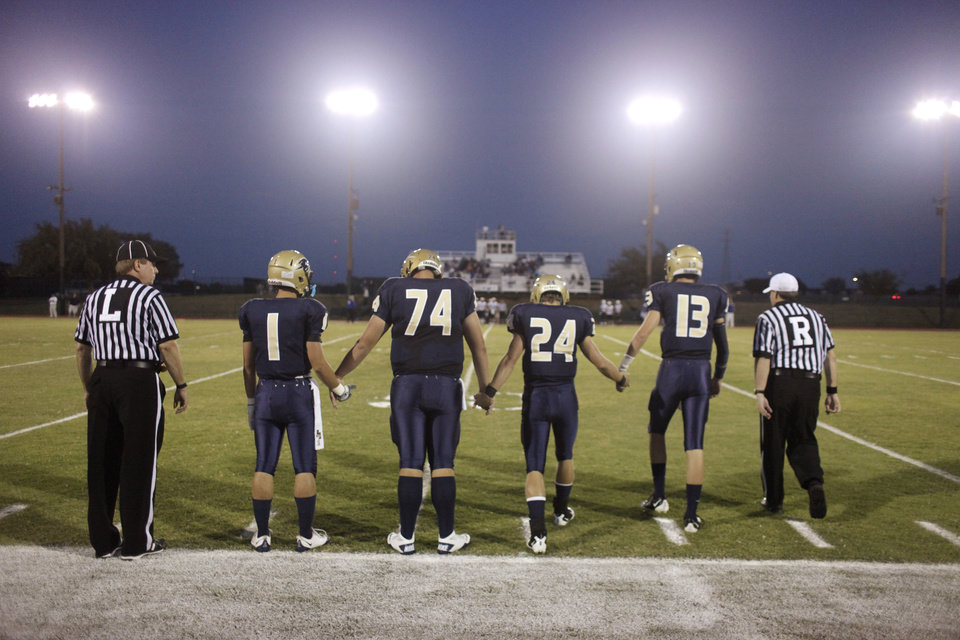 Photo - HH captains go out for the coin toss; #1 Graham Busby, #74 Bill Johnston, #24 Coby Brownrigg, #13 Cooper Cloud, during the high school football game between Heritage Hall and NOAH in Oklahoma City, Friday, Oct. 1, 2010. Photo by Doug Hoke, The Oklahoman.