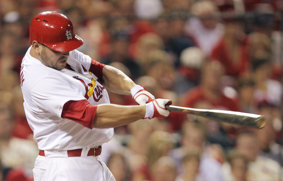 Photo - St. Louis Cardinals' Matt Holliday connects for an RBI single in the third inning of a baseball game against the Philadelphia Phillies, Friday, June 20, 2014, in St. Louis. (AP Photo/Tom Gannam)