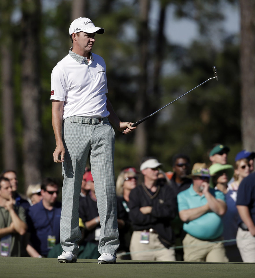 Photo - Jimmy Walker watches his putt on the first green during the first round of the Masters golf tournament Thursday, April 10, 2014, in Augusta, Ga. (AP Photo/Darron Cummings)