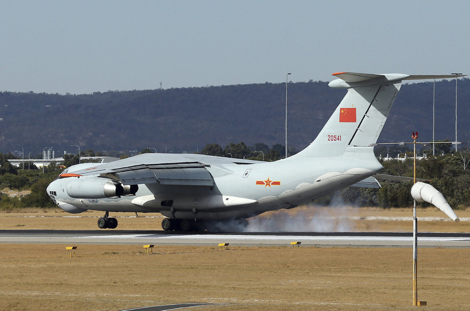 Photo - A Chinese Ilyushin IL-76 aircraft comes in for a landing at Perth International Airport after returning from the ongoing search operations for missing Malaysia Airlines Flight 370 in Perth,  Australia, Thursday, April 10, 2014. With hopes high that search crews are zeroing in on the missing Malaysian jetliner's crash site, ships and planes hunting for the aircraft intensified their efforts Thursday after equipment picked up sounds consistent with a plane's black box in the deep waters of the Indian Ocean.  (AP Photo/Rob Griffith)