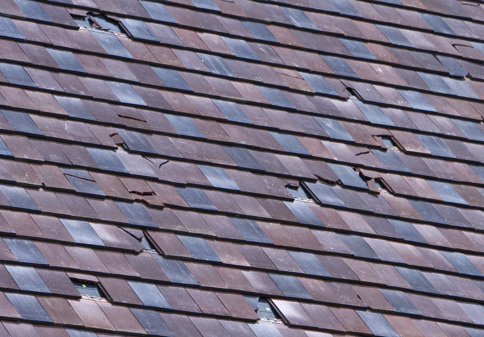 Broken slate roofing at Christ The King Catholic Church from last evenings hail storms, Wednesday, May 30, 2012. Photo By David McDaniel/The Oklahoman