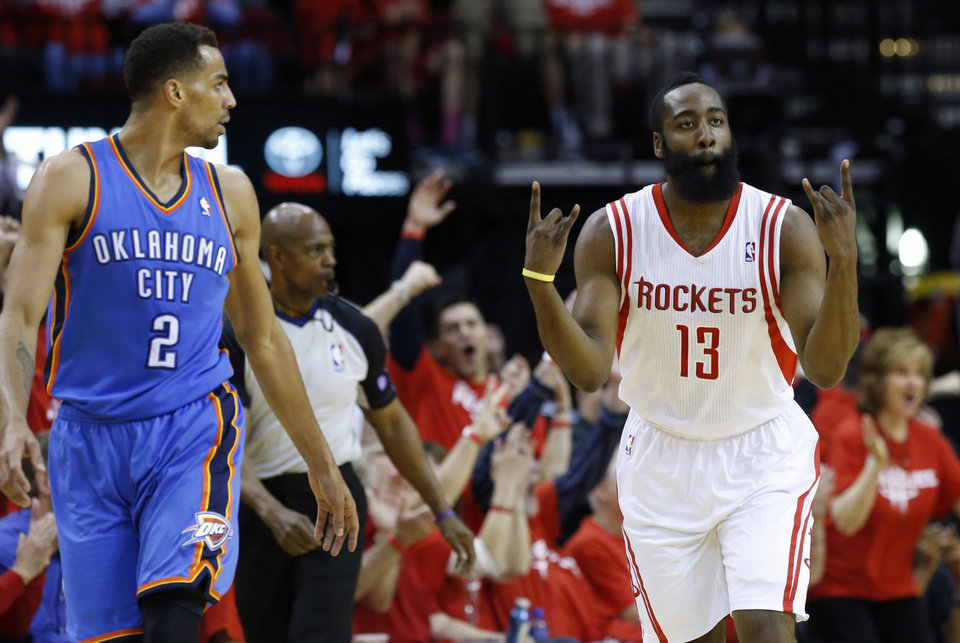 Oklahoma City's Thabo Sefolosha  stands beside Houston's James Harden as Harden celebrates a basket during Game 6 in the first round of the NBA playoffs between the Oklahoma City Thunder and the Houston Rockets at the Toyota Center in Houston, Texas, Friday, May 3, 2013. Photo by Bryan Terry, The Oklahoman