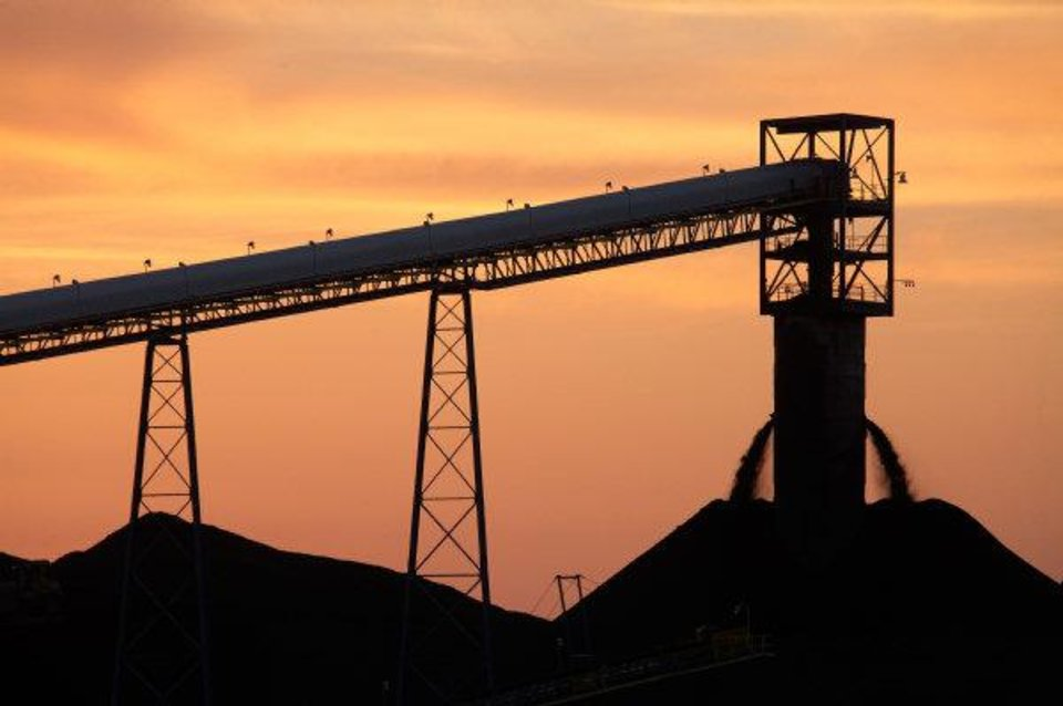 Photo - The caol sile and stockpiles at Alliance's River View operation in Kentucky are silhouetted at sunset in 2010.   - provided