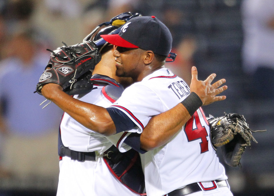 Photo - Atlanta Braves starting pitcher Julio Teheran (49) celebrates his complete game with catcher Gerald Laird at the end of a baseball game against the Milwaukee Brewers on Tuesday, May 20, 2014, in Atlanta. The Braves won 5-0. (AP Photo/Todd Kirkland)