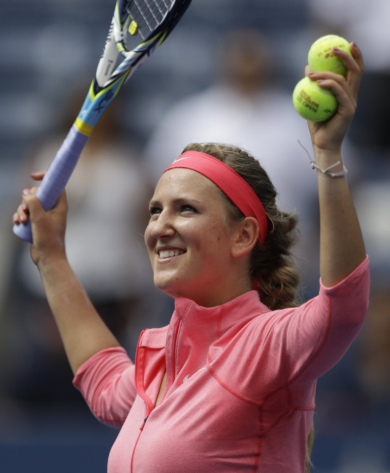 Victoria Azarenka, of Belarus, prepares to hit autographed balls to the crowd after beating Ana Ivanovic, of Serbia, in the quarterfinals of the 2013 U.S. Open tennis tournament, Tuesday, Sept. 3, 2013, in New York. (AP Photo/Julio Cortez)