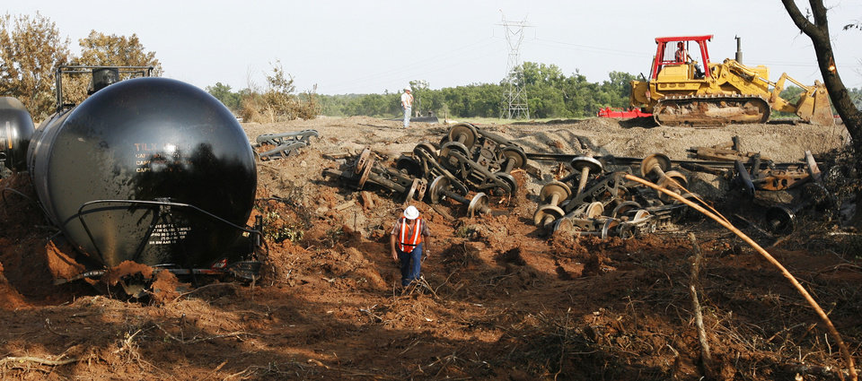 Photo - Cleanup continues Aug. 23, 2008, the day after a train derailment near Luther. PHOTO BY NATE BILLINGS, THE OKLAHOMAN ARCHIVES  NATE BILLINGS - THE OKLAHOMAN