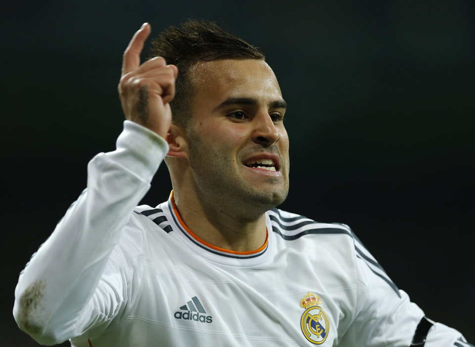 Photo - Real's Jese Rodriguez celebrates after scoring during a semi final, 1st leg, Copa del Rey soccer derby match between Real Madrid and Atletico Madrid at the Santiago Bernabeu Stadium in Madrid, Wednesday Feb. 5, 2014.  (AP Photo/Paul White)