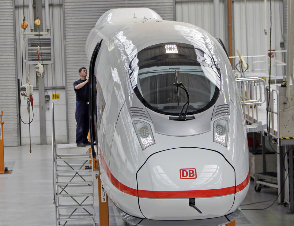 Photo - FILE - The April 28, 2010 file photo shows a worker assembling the doors at a new ICE high speed train, the ICE 3, at the train plant of Siemens in Krefeld, western Germany. German industrial equipment maker Siemens AG is launching a sweeping restructuring to raise profits and better compete with peers such as General Electric. as the company announced Wednesday, May 7, 2014. (AP Photo/Frank Augstein, file)
