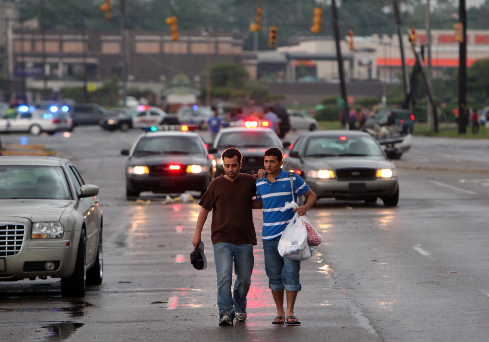 Photo - Residents search for belongings in Tuscaloosa, Ala. Wednesday, April 27, 2011. A wave of severe storms laced with tornadoes strafed the South on Wednesday, killing at least 16 people around the region and splintering buildings across swaths of an Alabama university town. (AP Photo/The Tuscaloosa News, Dusty Compton)