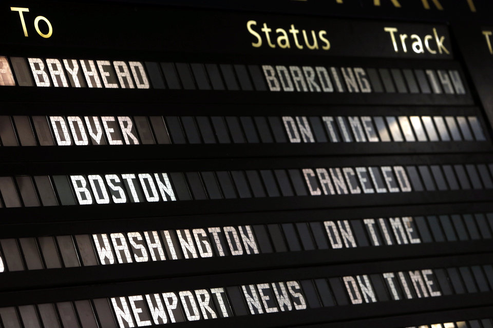The Amtrak departures board on Friday shows a canceled train to Boston at Penn Station in New York. Mass transit to and from the Boston area was virtually shut down Friday as police conducted a massive manhunt for a suspect in Monday�s Boston Marathon bombing. AP Photo
