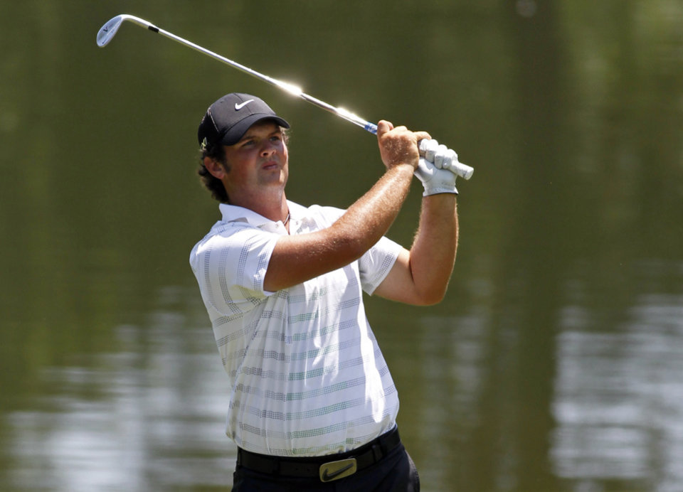 Photo -   Patrick Reed hits to the 15th green during the first round of the Wells Fargo Championship golf tournament at Quail Hollow Club in Charlotte, N.C., Thursday, May 3, 2012. (AP Photo/Bob Leverone)