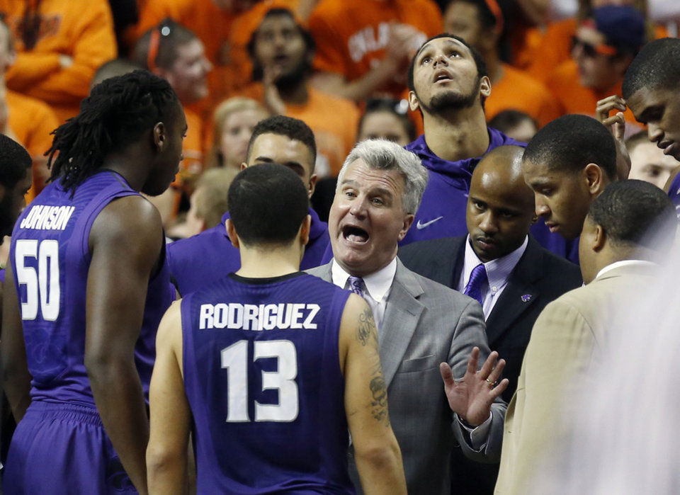 Photo - Kansas State head coach Bruce Weber, center, talks to his team during a time out in the second half of an NCAA college basketball game against Oklahoma State in Stillwater, Okla., Saturday, March 9, 2013. Oklahoma State won 76-70. (AP Photo/Sue Ogrocki)