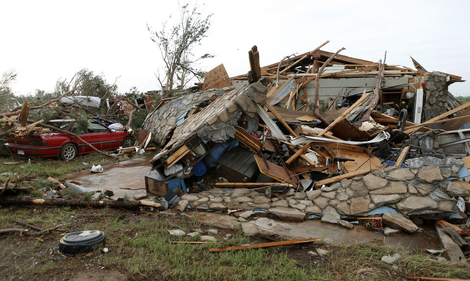 Photo - A home that was damaged by a tornado that moved through Carney Okla., on Sunday, May 19, 2013. Photo by Bryan Terry, The Oklahoman