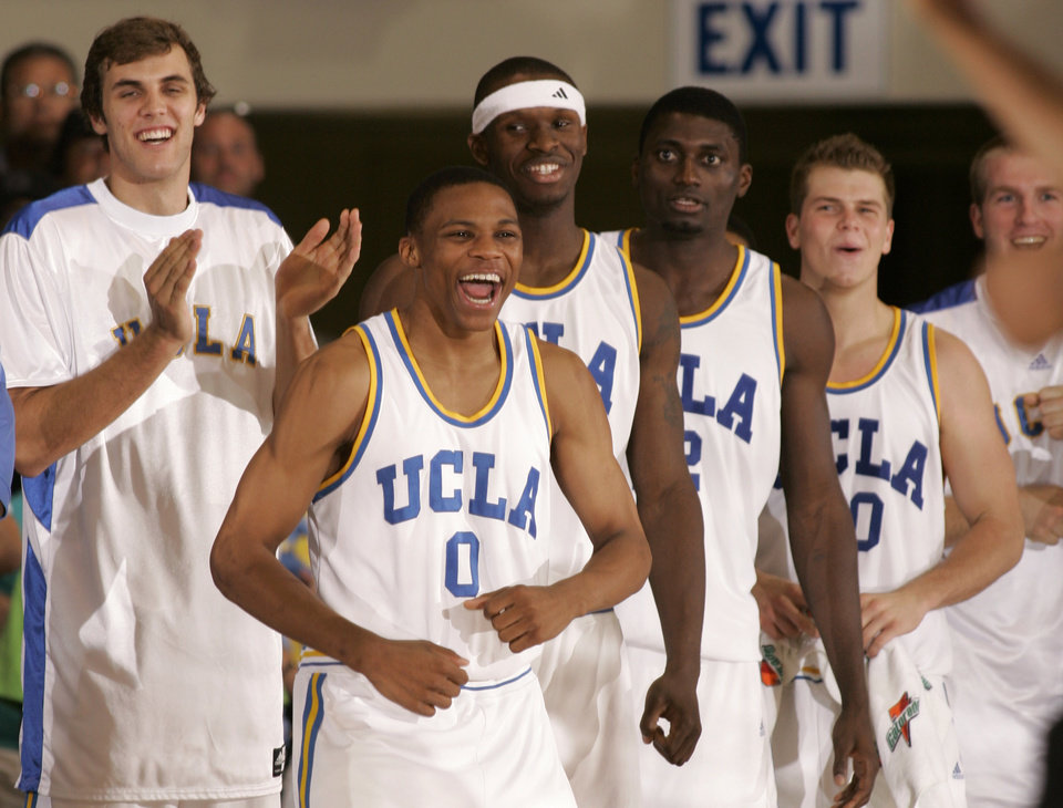 Photo - UNIVERSITY OF CALIFORNIA, LOS ANGELES / CELEBRATE / CELEBRATION: The UCLA bench including Russell Westbrook (0) celebrates in the closing seconds of a 73-68 win over Kentucky in a second round game at the Maui Invitational college basketball tournament in Lahaina, Hawaii Tuesday, Nov. 21, 2006.  (AP Photo/Michael Conroy) ORG XMIT: HIMC121