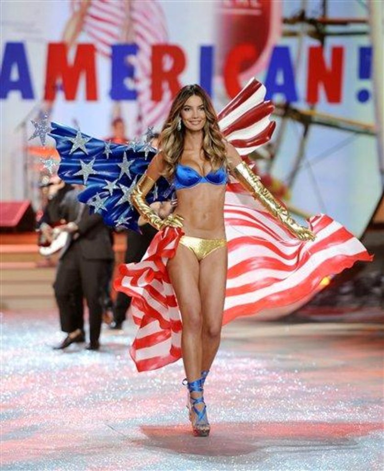 Photo - Model Lily Aldridge walks the runway during the 2012 Victoria's Secret Fashion Show on Wednesday Nov. 7, 2012 in New York. The show will be Broadcast on Tuesday, Dec. 4 (10:00 PM, ET/PT) on CBS. (Photo by Evan Agostini/Invision/AP)
