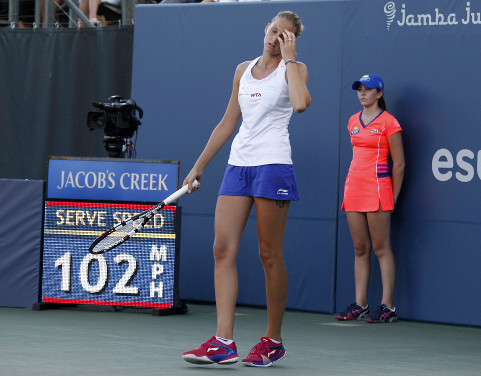 Photo - Karolina Pliskova reacts after giving up a point during the first set of her match against Serena Williams  in the Bank of the West Classic, Wednesday, July 30, 2014, in Stanford, Calif. (AP Photo/Beck Diefenbach)