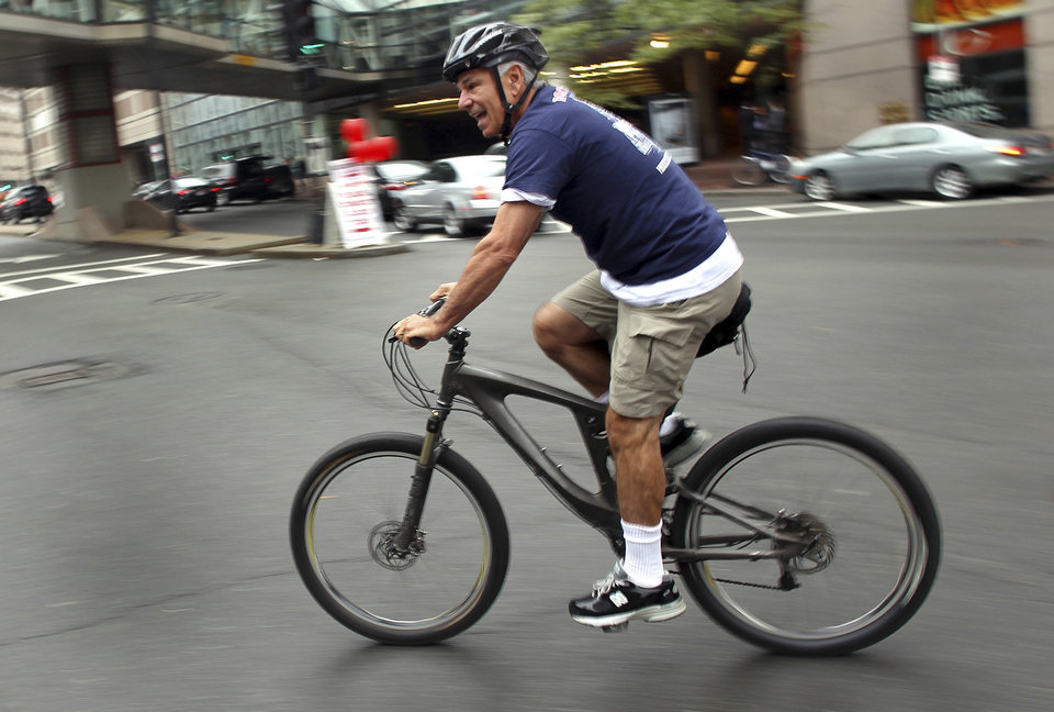 Former Boston Red Sox Manager Bobby Valentine goes for a bike ride on Boston's Huntington Ave., Thursday, Oct. 4, 2012. Valentine was fired Thursday, the day after the Red Sox ended the season with a record of 69-93, the ball club's worst record in almost 50 years. (AP Photo/The Boston Globe, John Tlumacki) MANDATORY CREDIT. NO ONLINE USE. MAGS OUT. NO SALES. BOSTON OUT. QUINCY OUT.